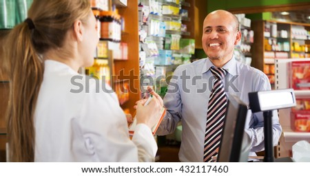 Mature man near counter in pharmacy drugstore