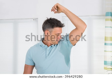 Mature Man Notices His Sweat Under Armpit - stock photo