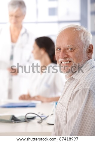 Mature man on health control in doctor's room.?