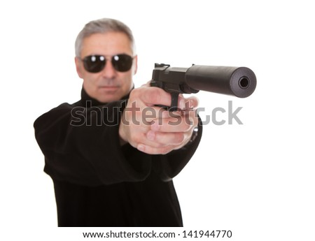 Mature Man Over White Background Aiming With Handgun - stock photo