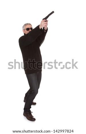 Mature Man Over White Background Aiming With Handgun - stock photo