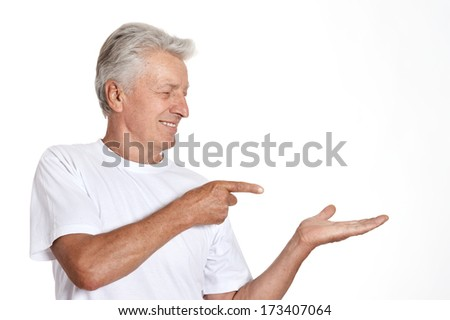 Mature man pointing with his finger on white background - stock photo