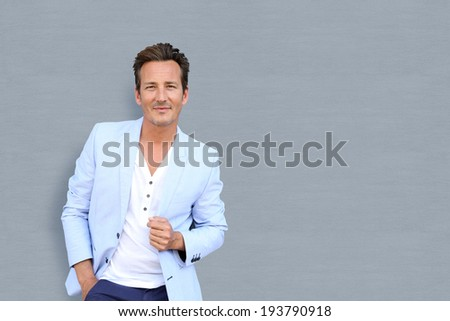 Mature man standing on grey background - stock photo