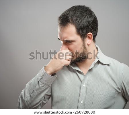 Mature man suffering from sinus pressure pain. - stock photo