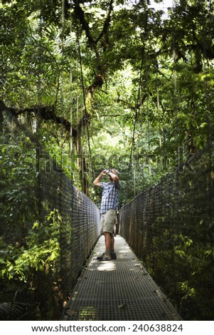 Mature Man Taking Picture in Wilderness Area - stock photo