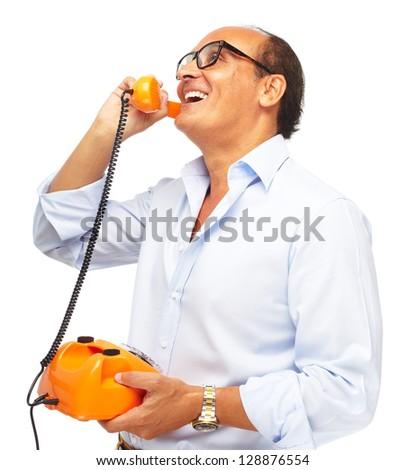 Mature Man Talking On Telephone On White Background - stock photo