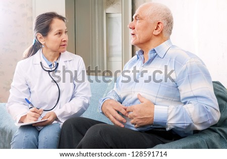 Mature man tells the doctor the symptoms of malaise on couch - stock photo