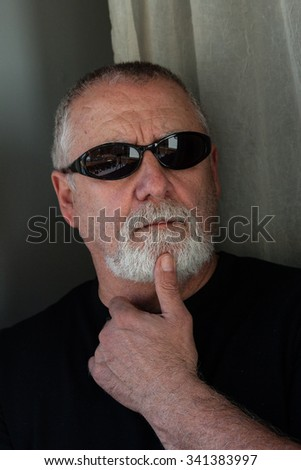 mature man with a beard and sunglasses