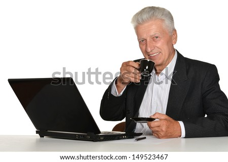 mature man with a laptop on a white background