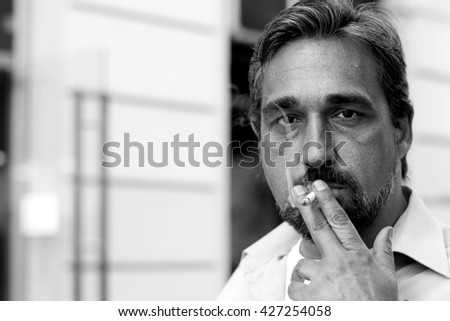 Mature man with cigarette