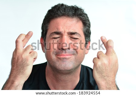 Mature man with crossed fingers hoping for good luck. close up on white background. real people. Concept photo of wish, wishing, luck , lucky, hope, hoping, fear,help,expectation, praying,optimism. - stock photo