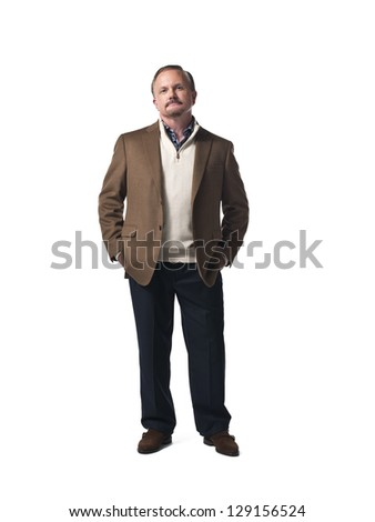 Mature man with hands in pocket over white background