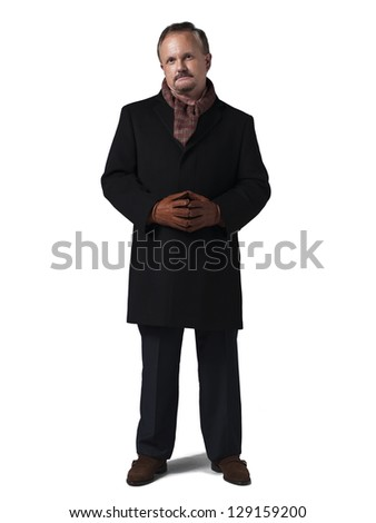 Mature man with hands together over white background