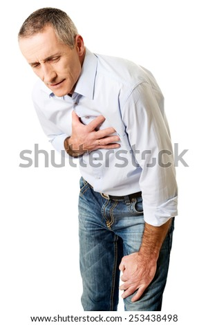 Mature man with heart disease bending. - stock photo