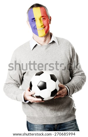 Mature man with Moldova flag painted on face.