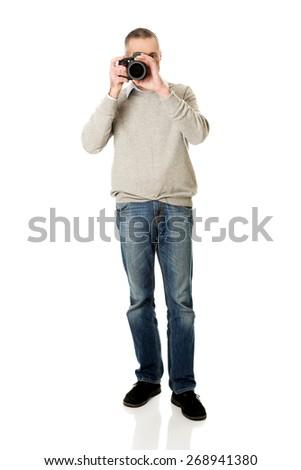 Mature man with professional photo camera. - stock photo