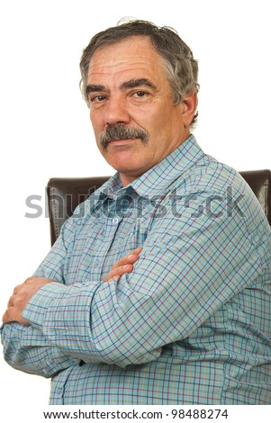Mature manager man sitting on chair with arms folded isolated on white background