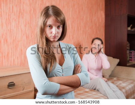 Mature mother and  daughter  after quarrel at home