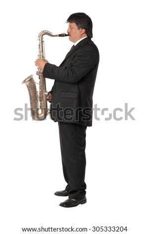 Mature musician man playing saxophone - stock photo