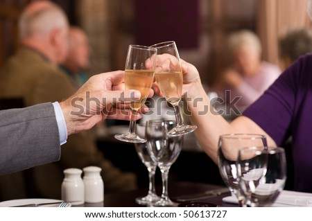 Mature older couples enjoying a celebration in a restaurant