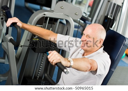 Mature older man working out in the gym