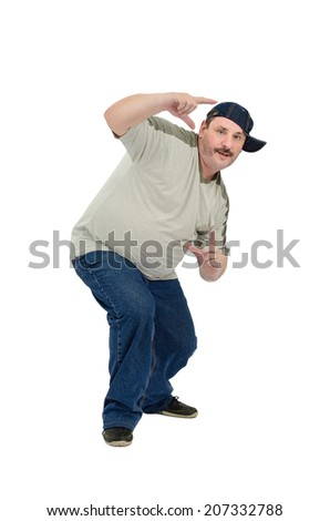 Mature overweight guy learning to dance rap  music on white background