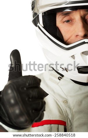 Mature race driver showing ok sign