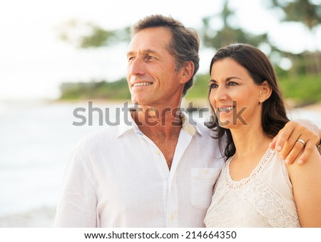 Mature Retired Couple Enjoying Tropical Sunset Beach Vacation - stock photo