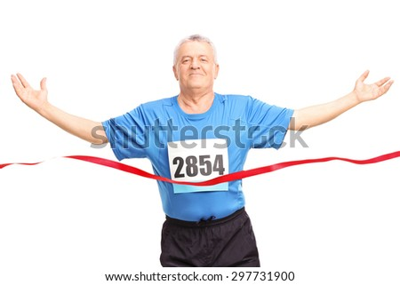 Mature runner finishing a race and celebrating his victory isolated on white background - stock photo