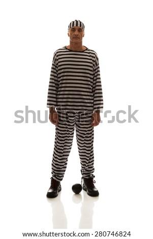Mature sad man prisoner criminal with chain ball. - stock photo