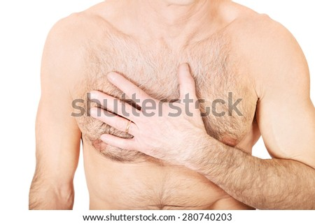 Mature shirtless man with chest pain.