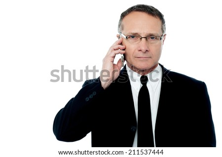 Mature smart businessman calling by the phone