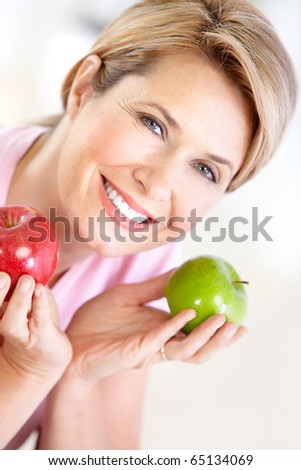 Mature smiling woman with apples
