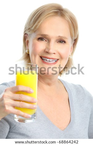 Mature smiling woman with orange juice - stock photo