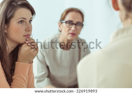 Mature spiritual guide talking with young women