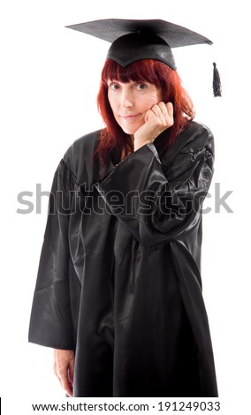 Mature student standing with her hand on chin