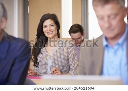 Mature Students In Further Education Class - stock photo