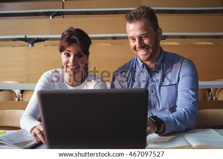 Mature students using laptop in the classroom