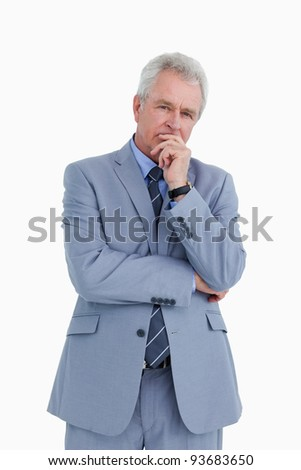 Mature tradesman in thinkers pose against a white background - stock photo