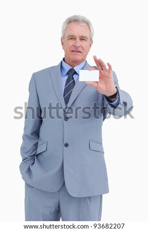 Mature tradesman showing his business card against a white background