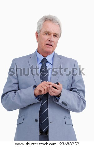 Mature tradesman with his cellphone against a white background