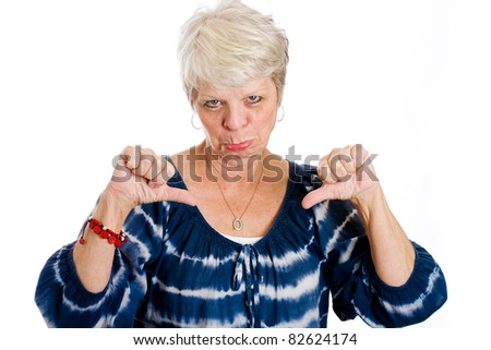 Mature white haired woman showing her unhappiness with two thumbs down. - stock photo