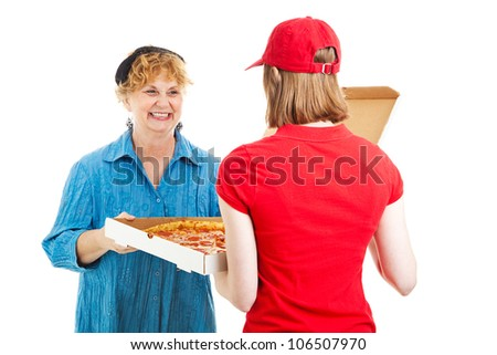 Mature woman accepting a pizza from a young delivery girl.  Isolated on white. - stock photo