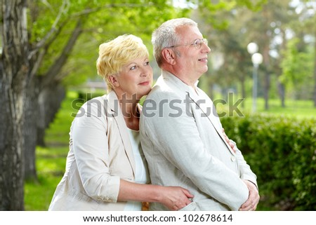 Mature woman and her husband having rest outside