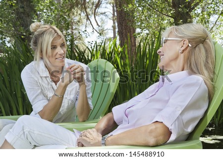 Mature woman and mother having a quality time at park - stock photo