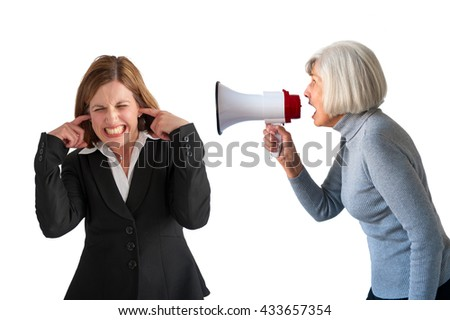 mature woman being shouted at by senior woman on white - stock photo