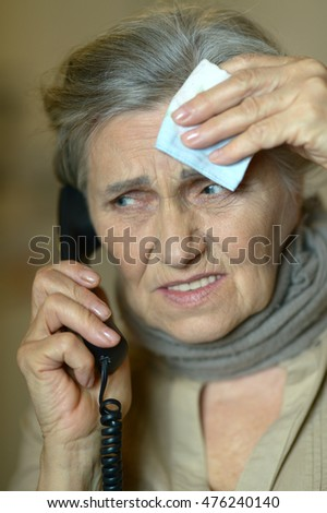 Mature woman calling doctor