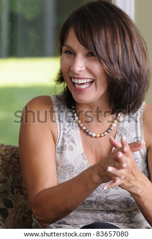 Mature Woman Caught Laughing At A Party - stock photo