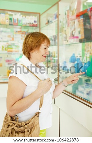 Mature woman chooses enema at the pharmacy