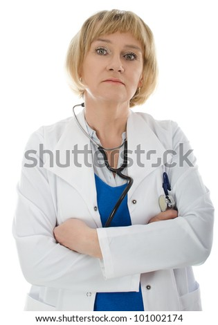 Mature woman doctor wearing white coat isolated on white background - stock photo